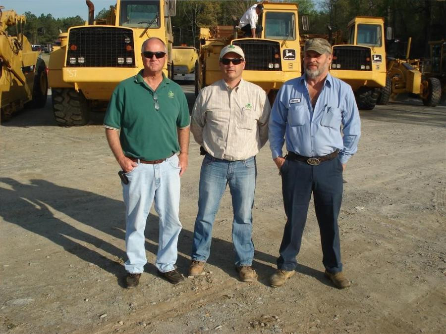 (L-R): Tom and Scott Sullivan, both of Sullivan Eastern, Durham, N.C.; and Jimmy West, West Land Clearing, Spring Lake, N.C.; were interested in the John Deere scrapers.