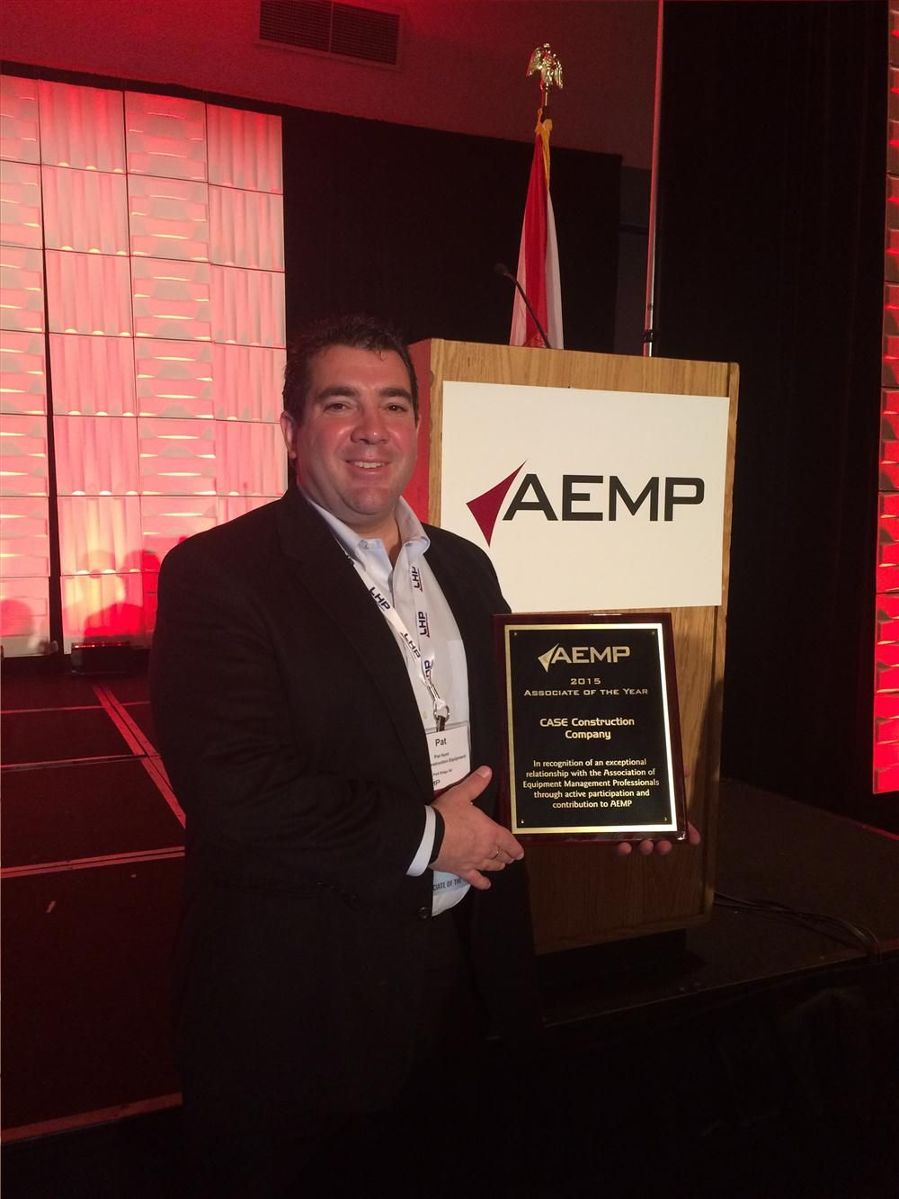 Pat Hunt, CASE Construction Equipment's Director of Strategic Accounts, accepts the Associate of the Year award at the annual AEMP conference in Orlando.