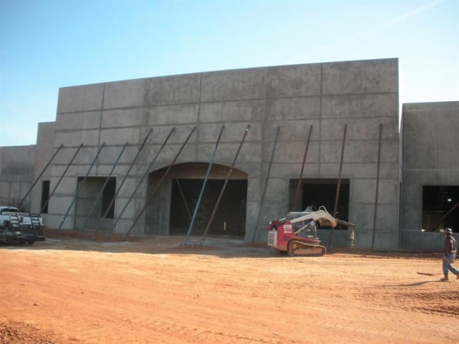 Academy Sports building with front in place; supports have not yet been removed.