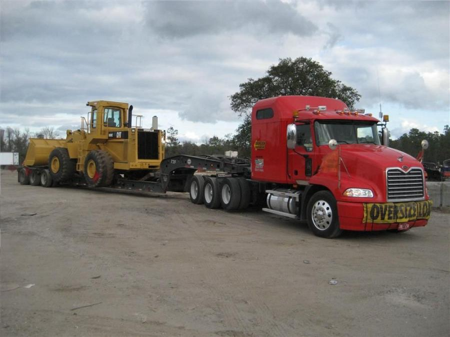 "Gary Ayers, vice president of Arlington Heavy Hauling, said that the company likes to say that they will haul anything ""yellow"" such as Caterpillar equipment."