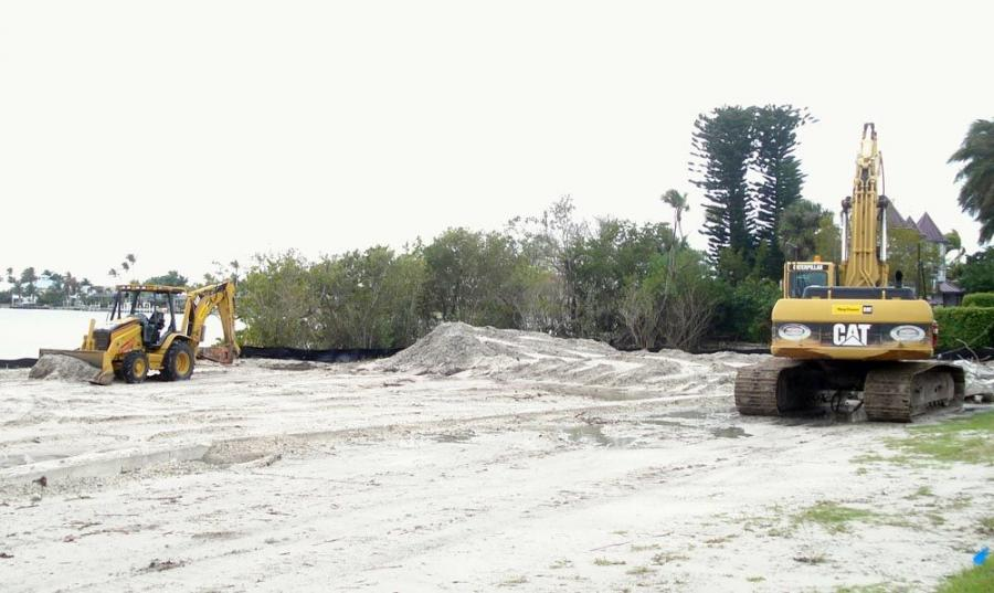 A Cat 430D tractor backhoe and Cat 330 excavator are being used to excavate retention ponds and demo a seawall.