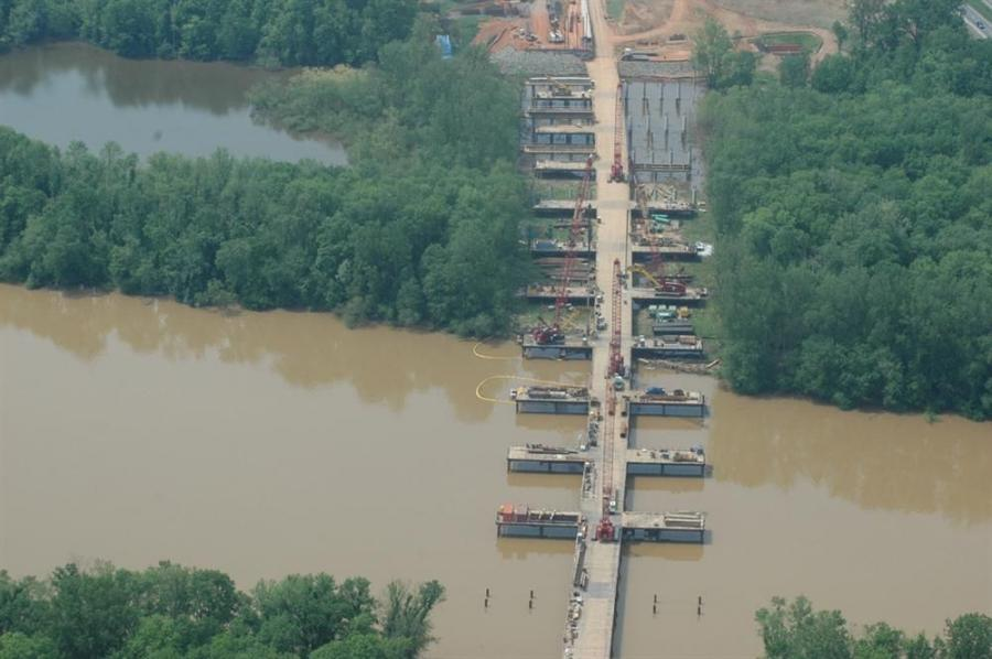 """Photo courtesy of the N.C. Department of Transportation The crews building the new I-85 bridges over the Yadkin River are getting a helping hand from the platforms, or """"fingers,"""" that extend out from the temporary work bridge."""