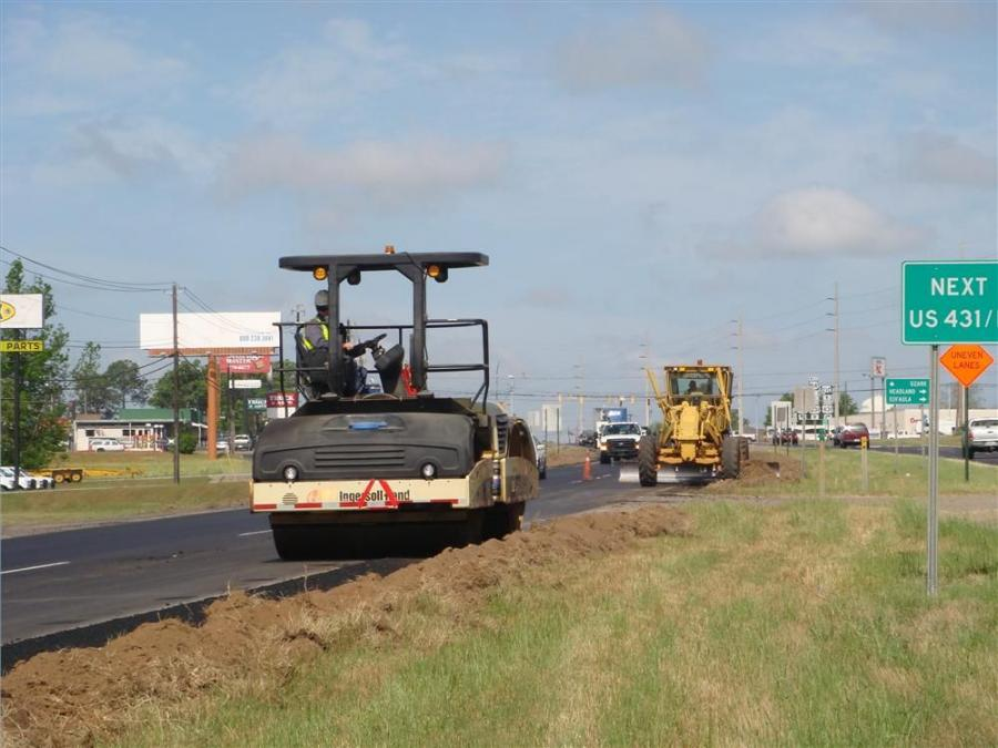 APAC forces compacting the newly constructed 2 ft. (.6 m) asphalt shoulder work.