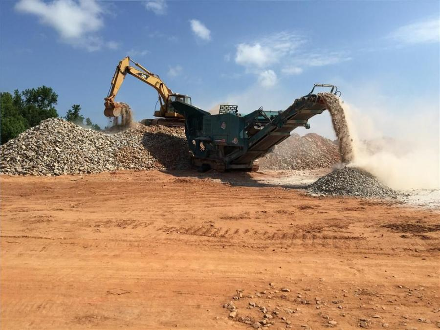 The operator of the Cat excavator feeds the Powerscreen XR 400 jaw crusher that sizes the material to 6 in. (15.2 cm) minus.