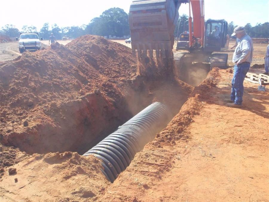 Scott Roberson, Mobile Public Schools photo Crews ran 3,500 linear ft. (1,066 m) of concrete curb and gutter and roughly 3,500 linear ft. of new storm drain HDPE pipe, according to Jerry Gordon, project manager.
