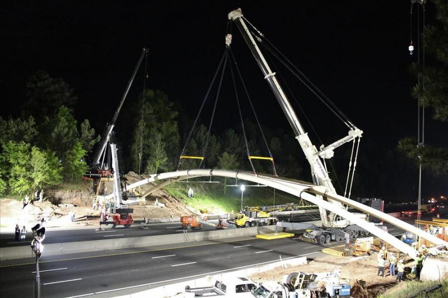 Two Link-Belt 90-ton (81.6 t) assist cranes were used, one on each side of the interstate, to help guide the ends of the bridge into place for bolting.
