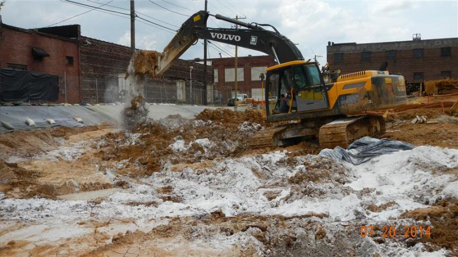Donna Strange, Hoar Construction photo Crews mix lime and dirt during the micro pile process.