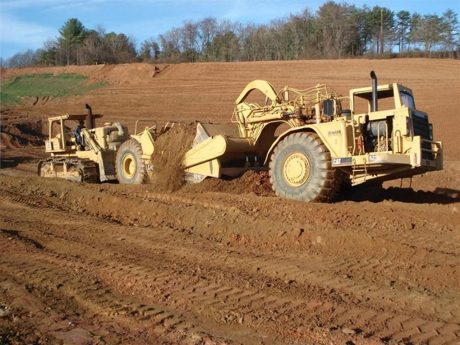 The job involves moving more than 450,000 cu. yds. (344,050 cu m) of material.