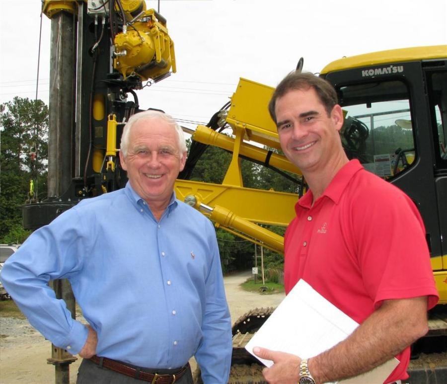 Allen Cellar (L) of Drillers' Choice Inc. and Mack Brice, sales representative of Tractor & Equipment Company, discuss future machine purchases.