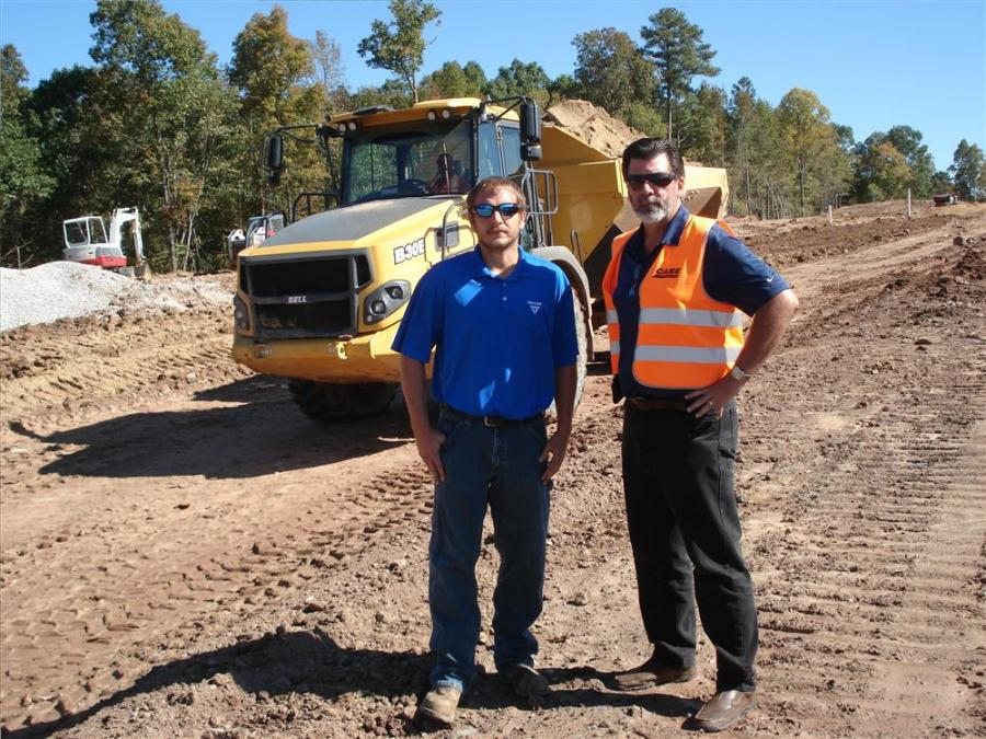Triton Siteworks Development moves 5,000 to 6,000 cu. yds. (3,823 to 4,587 cu m) of material a day with artic trucks at the Jordan at South Point development in Durham.  Jason Thomason (L), fleet manager of Triton, and Larry Hudson of Hills Machinery disc