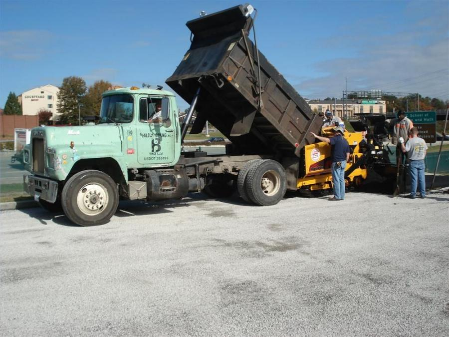 Lee Blalock leads the paving crew at a paving project in the parking lot of St Luke's Episcopal Church in Durham, N.C.