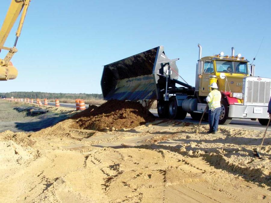 Lane Hauling & Excavating Inc., based in Clarkrange, Tenn.,, has been using side-dump trailers to place the fill at a few places along the construction route.