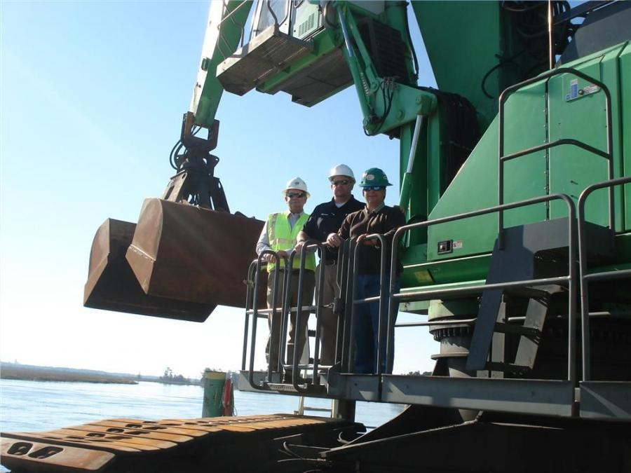 "(L-R): Mitch Bailey and Rob Jordan, both of ASC and Turner Fabian, president of Charleston Bulk Transfer, enjoy a bird's eye view of the hopper from the elevating cab of the Sennebogen 880. ""The Sennebogen 880 and pier are a perfect fit,"""