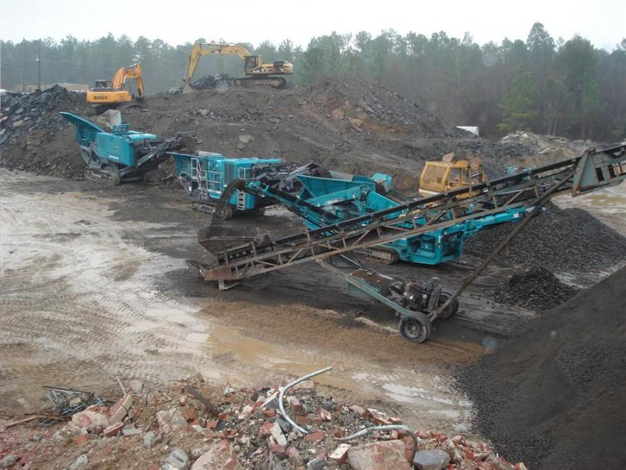 According to Ian Williamson, Powerscreen Mid-Atlantic's sales manager, the jaw crusher reduces the old asphalt and concrete into a minus 6-in. (15.24 cm) product, then the impactor turns it into a minus 2-in. (5.08 cm) stone and the screen removes t