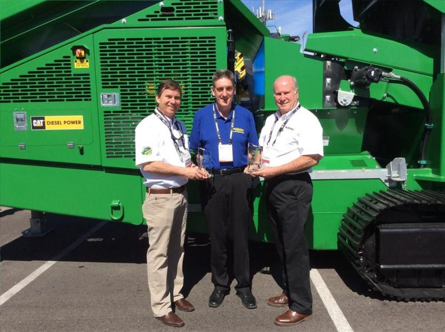 American Crushers and Screens won two awards at ConExpo. One of the awards was for the fastest growing dealer in 2013 and the other was for selling the highest number of 100 ft. track stackers in 2013.  (L-R): Mike Andrews, American Crushers & Screens; Pa