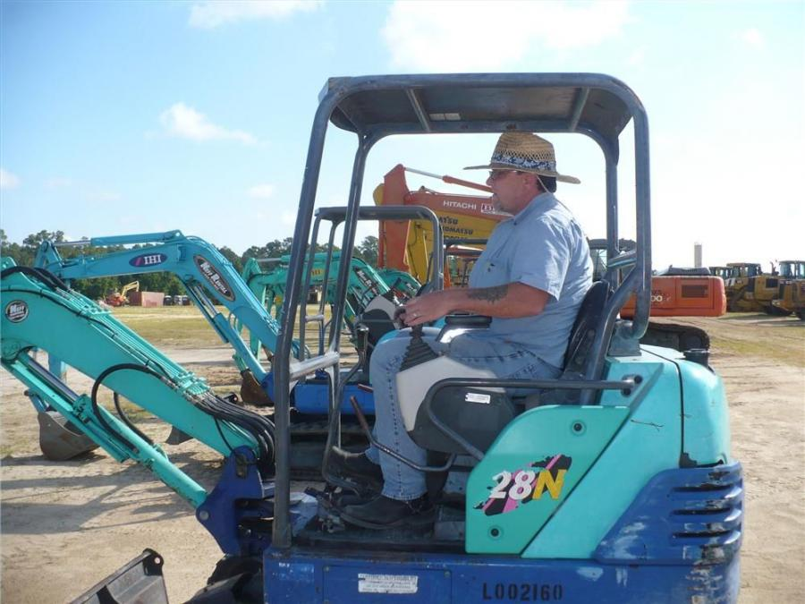 Anthony Jacobs of Southern Development Group in Spring Hill, Fla.,  tries out several IHI mini-excavators.