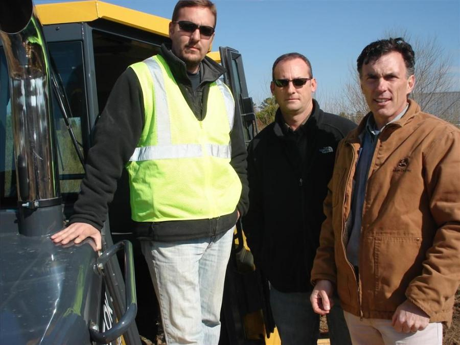 (L-R): Jason Riffle and Jason Pleasants of Kenneth West Inc. in Apex, N.C., arrive to demo three machines.  Brian Metcalf of RW Moore explains the benefits of the Deere 750K LGP machine.