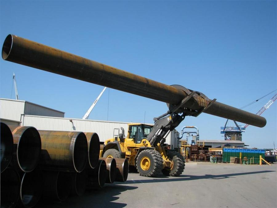 The operator of a Volvo L220G with specialty forks moves an 80 ft. (24.3 m) pipe with ease around the Berg steel pipe yard in Panama City, Fla.