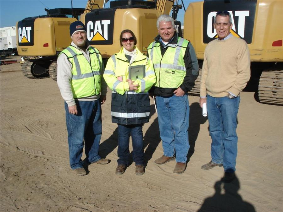 The Blanchard CAT yard sale consisted of 70 machines ranging from excavators, to logging equipment and skid steer loaders. (L-R): Art Catoe, Angela Plaugh, John Spires and Harry Hurley attend the event.
