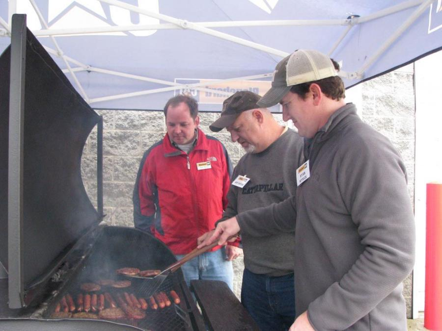 Blanchard Machinery's product support staffers grill up burgers and hot dogs. (L-R) are Chris Pierson, Art Catoe and Ryan Myrick.