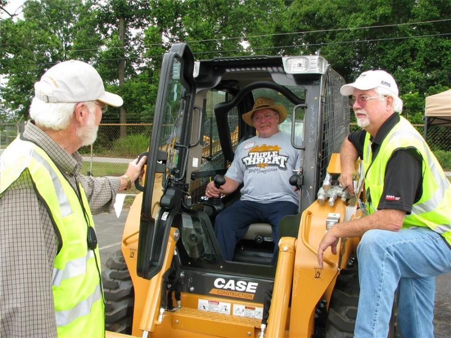 After a terrific run in the skid steer showdown portion of the rodeo event, Michael Touchet (in cab), American Contractors, Lithia Springs, Ga., talks about the challenging course with Michael Abney (L), Border Equipment, Conley, Ga., and Marty Ward, Bord