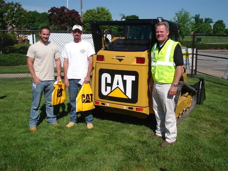 (L-R): Zach and Josh Winchester of Winchester Grading in Monroe, N.C., talk to John Crocker of Carolina CAT about the Cat 259B series 3 compact track loader.