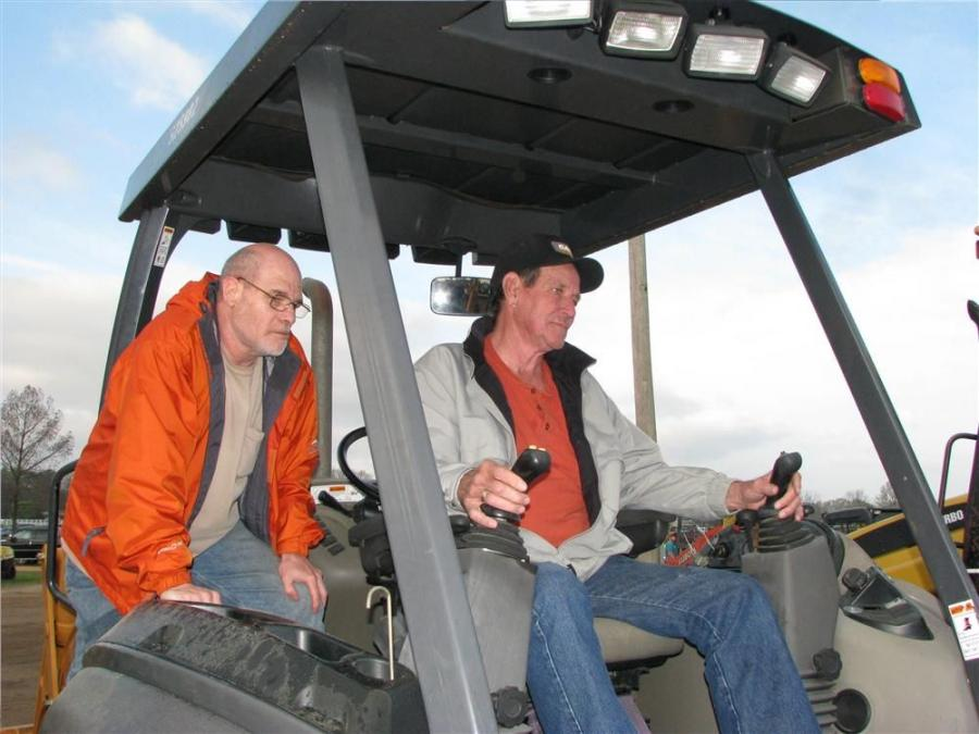 Todd Stewart (L), operating engineer, IUOE local 369-Memphis, Tenn., and Donnie Warren, independent contractor, Clifton, Tenn., test operate a Case 580 Super M backhoe loader.