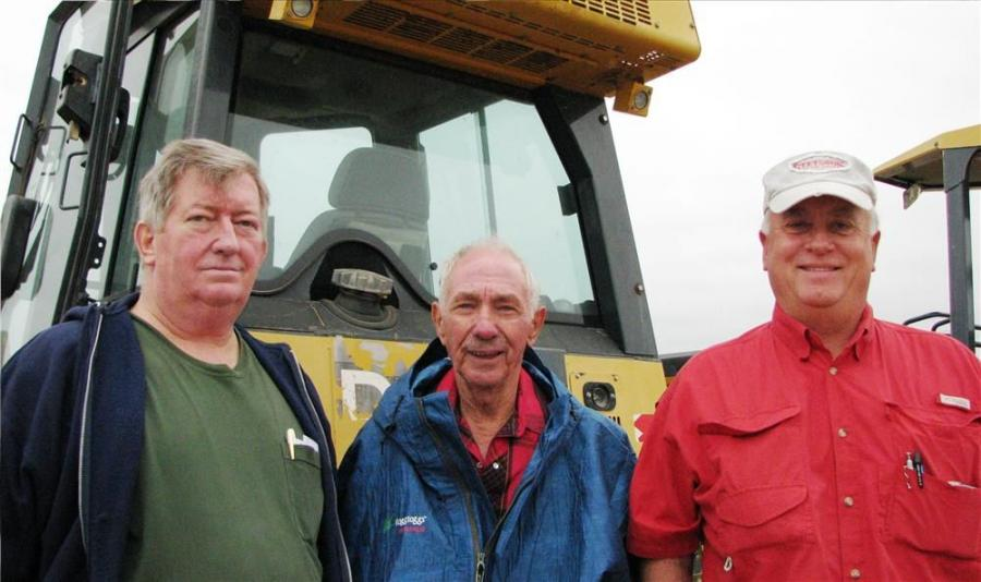 Four Deere 650J LGP's about to go on the auction block caught the attention of these Oxford, Miss., based contractors. (L-R) are Tommy Brown and John Fortuner, both independent contractors; and Bruce Patterson, Patterson Farms & Construction.