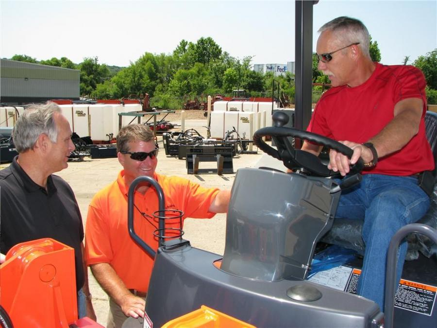 Enjoying the day's events and checking out a Kubota R420S compact wheel loader on display are (L-R) Bobby Gaines, Stansell Electric, Nashville, Tenn.; Mike Thilmony, Ditch Witch of Tenn.; and Bobby Couts also of Stansell Electric.