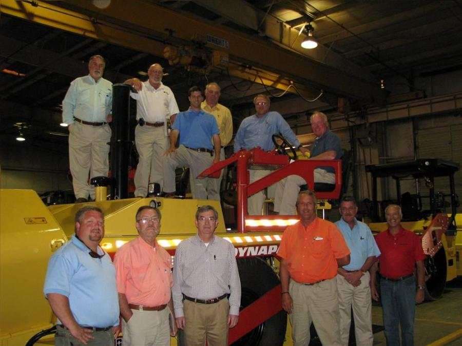 After classroom sessions, some of the Flint Equipment Company sales staff assembled for a photo in Albany, Ga., on a Dynapac F1000W wheeled paver.