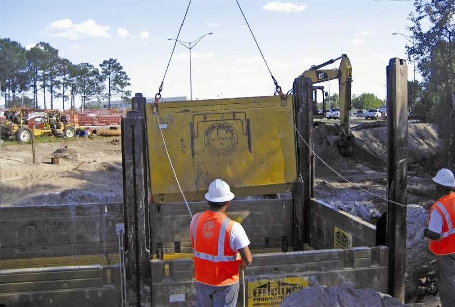 J.B Coxwell Contracting originally planned on using sheet piling to shore the microtunneling launch and receiving pits, but instead went with an Efficiency Production manufactured slide rail system supplied by distributor Professional Shoring & Supply.