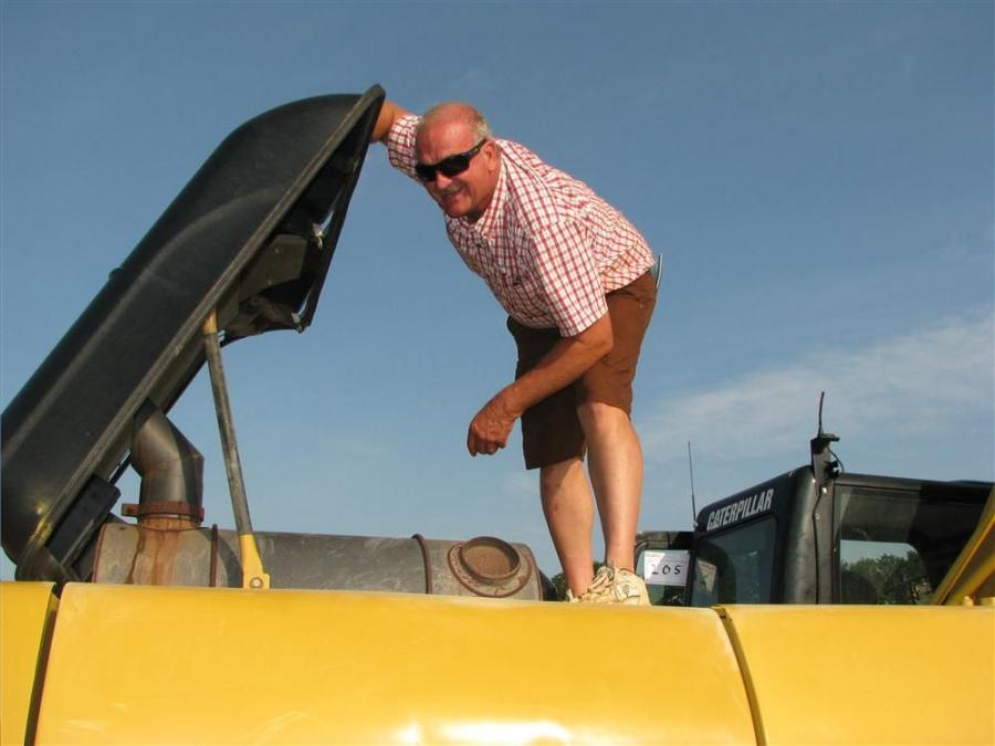 Miles Mauldin of Mauldin Excavating, Dawsonville, Ga., completes a comprehensive inspection of a Cat 336DL excavator.