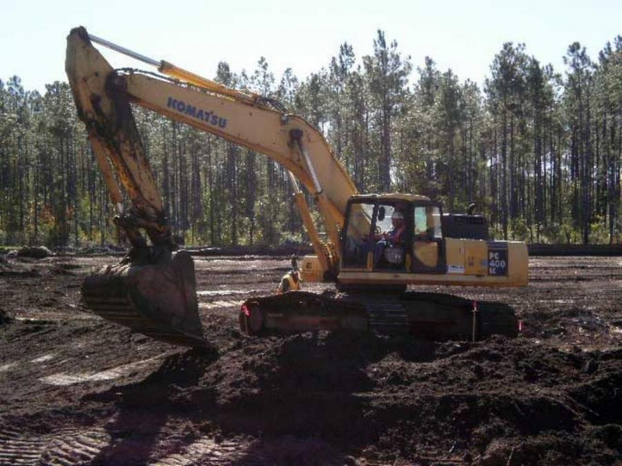 A Komatsu PC 400 excavator toiling in the unexpectedly wet soil at the project site.