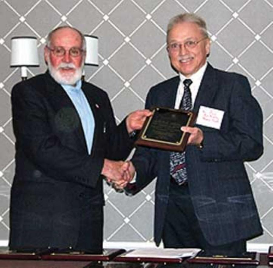 Current NUCA Safety Committee Chairman, L.D. Alexander (L) presented the award to Raymow President Bud Bradley.