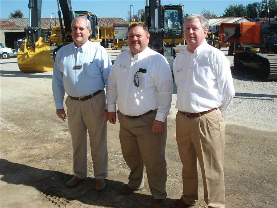 Danny Bollinger (C), and Bob Thompson (R), both of Flint Equipment Company, welcome Bill Banning chairman, Lexington County Council.