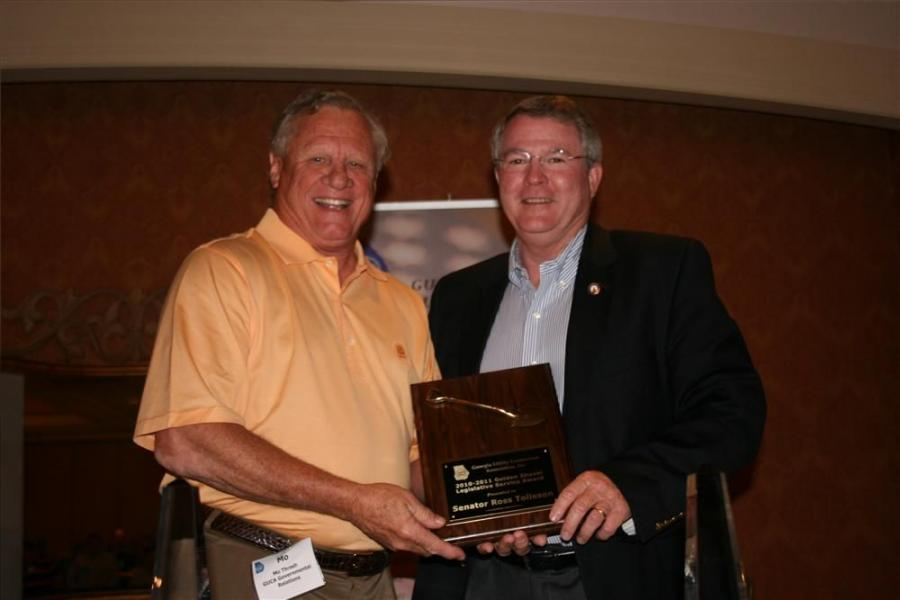 GUCA Lobbyist Mo Thrash (L) presents the GUCA Golden Shovel Legislative Service Award to Sen. Ross Tolleson.