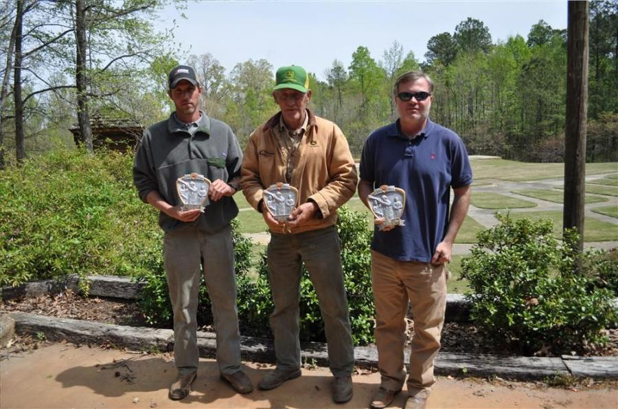 Christopher Grading Inc. takes home the first place trophy at the sporting clay event.