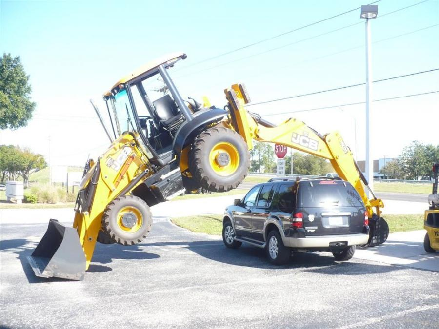 Would you trust your car in this situation? JCB did, showing off the strength of JCB backhoe hydraulics.