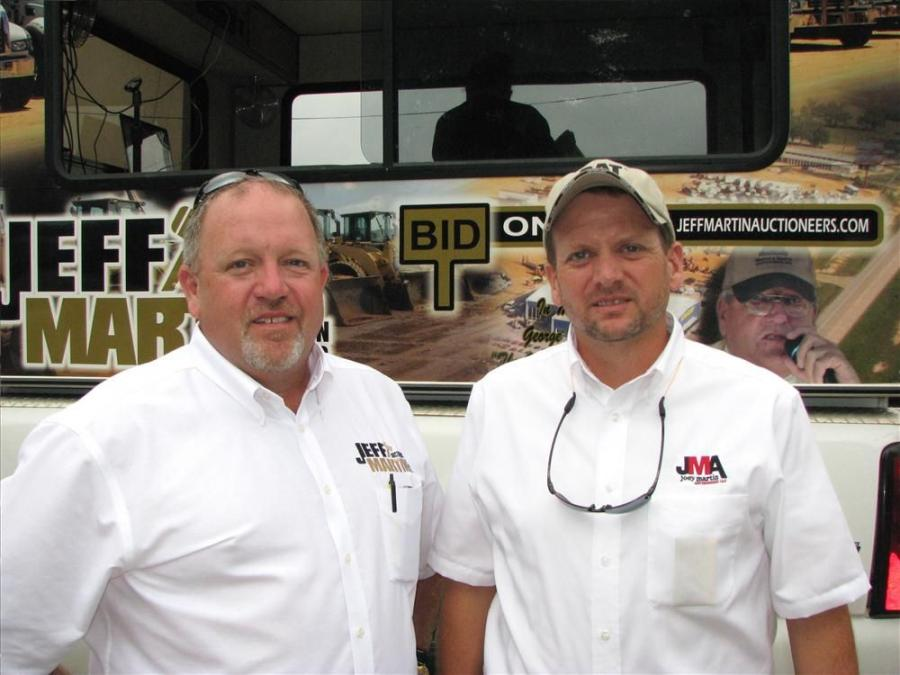 Jeff Martin (L) and Joey Martin are ready to start the bids at the sale in Norcross, Ga.