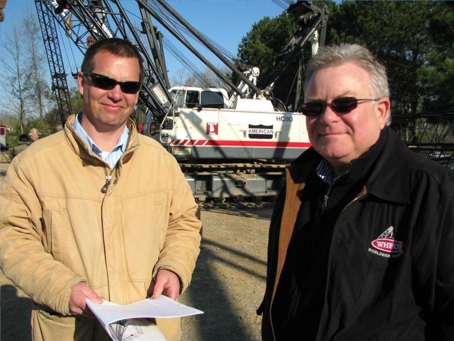 Mark Seeley (L) of Miller & Miller, Huntsville, Ala., and Greg Etue of WHECO Corporation, Aiken, S.C., talk about the cranes up for sale.