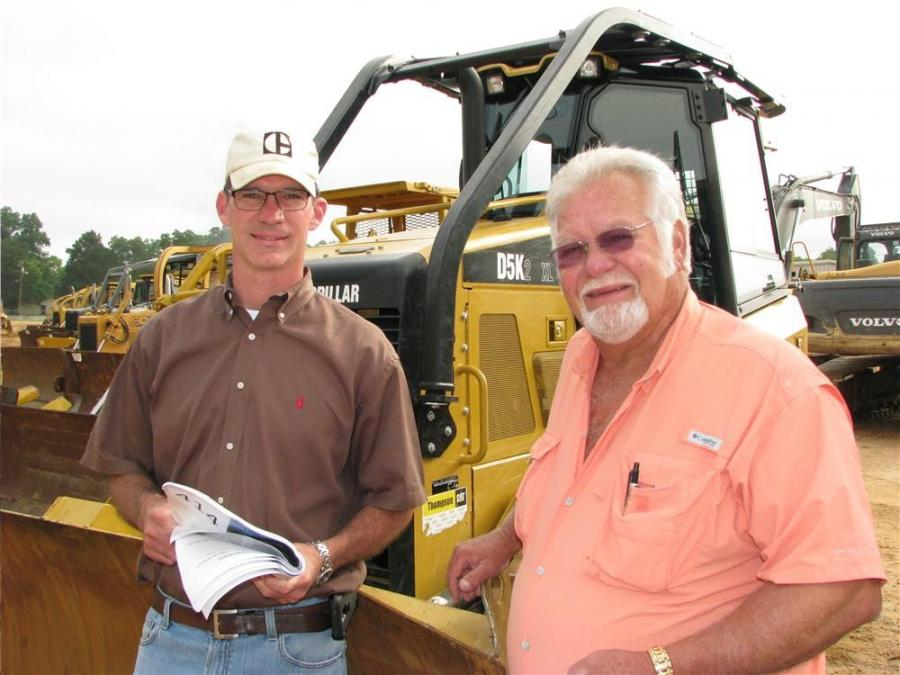 Brett Johnson (L) of Vertical Earth, Cumming, Ga., and Dick Tabb, Tabb Equipment Sales, Marietta, Ga., look over dozers about to go on the auction block.