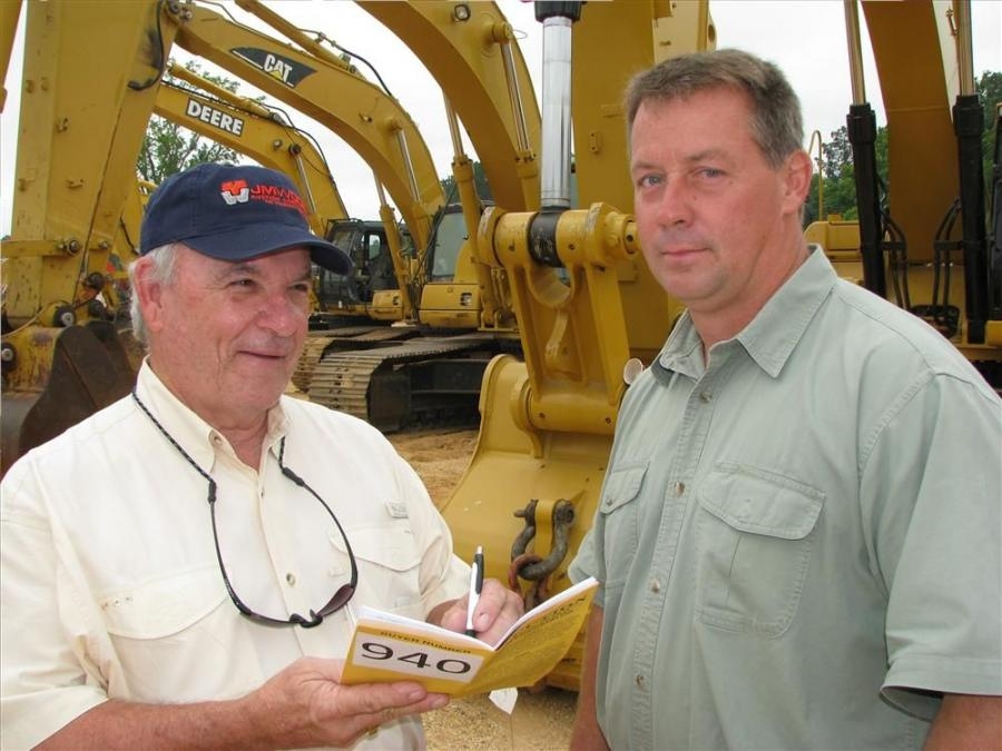 Talking about what's going on in the used equipment business are Jerry Cole (L), C & C Equipment, Hattiesburg, Miss.; and Bill Woods  Woods Equipment Co., Nashville, Tenn.