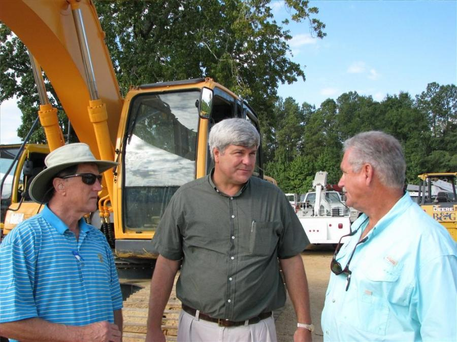 (L-R): Philip Parker and Trip Pittman of Pittman Tractor, Daphne, Ala., discuss some machines of common interest with Wayne Eldridge of J & W Marine, Bayou La Batre, Ala.