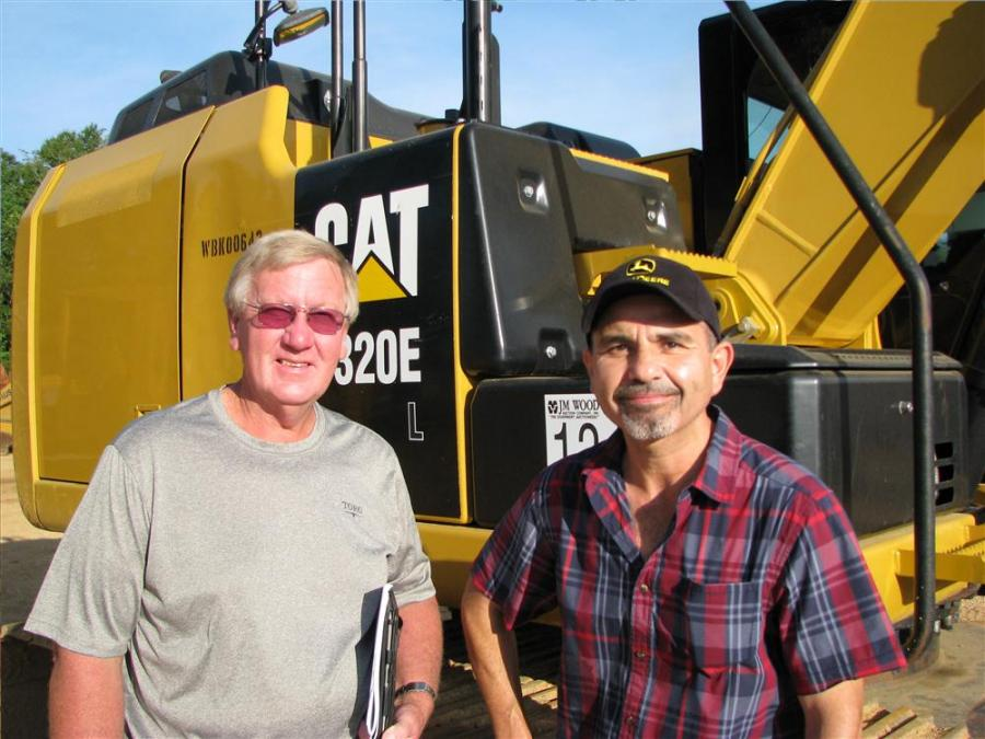 Billy Seals (L) of Thompson Tractor, Birmingham, Ala., and Carlos Garcia, an equipment dealer based in Texas, talk about the machine lineup.