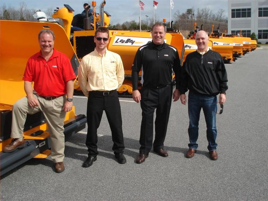 In front of the lineup of LeeBoy world class pavers are (L-R) Bryce Davis, Jeremiah Reinhardt and Scott Carey, all of LeeBoy; and Jim Hassebrock, Modern Machinery, Seattle.