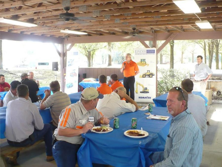 Visitors at the demo enjoyed a barbecue lunch  while a speaker addressed the crowd.