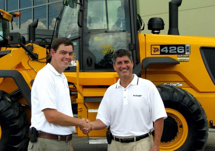 Shaking hands on the deal for the purchase of six JCB 426s are Coastal Concrete's CEO Tim Coleman (L) and Low Country Machinery President Rick Piper.