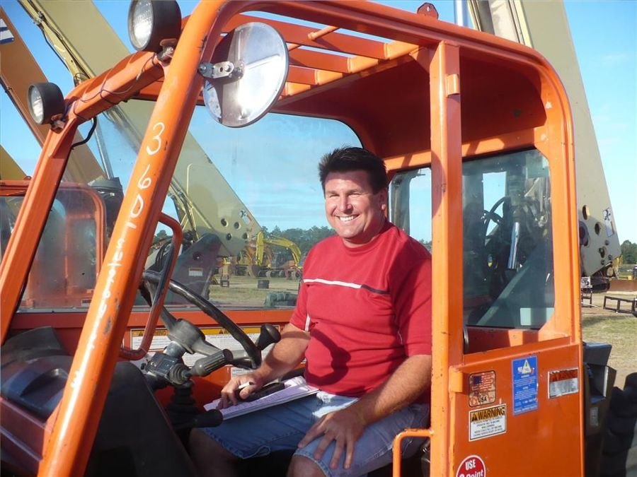Richard Hardman of Hardman Trucking Inc. considers bidding on this JLG personnel lift.