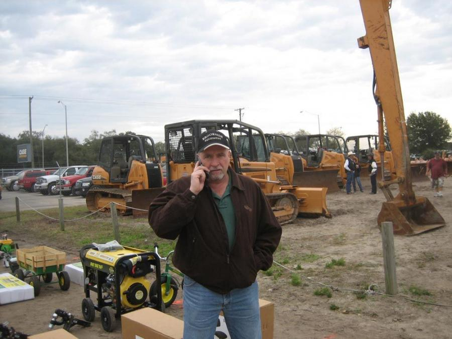 Roger McHugh, president of Brookside Equipment, makes another deal via cell phone.