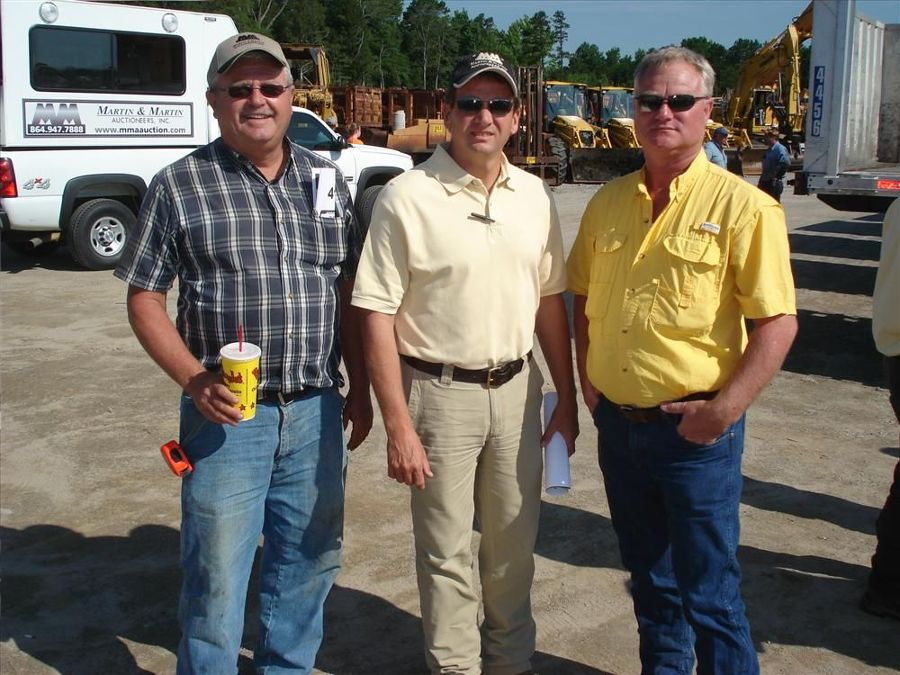 Joey Martin (C), welcomes Gary Miller (L),  Miller Land Clearing, Aiken, S.C.; and Henry Beard with Beard Grading also in Aiken, S.C.;  to the sale.